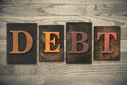 Debt Concept Wooden Letterpress Type